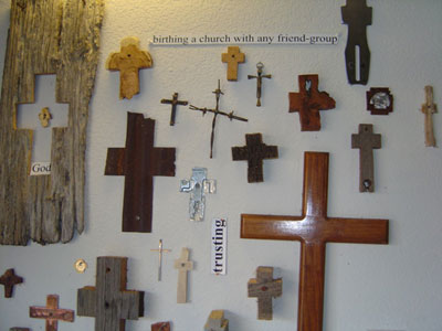A variety of crosses hang on a wall.